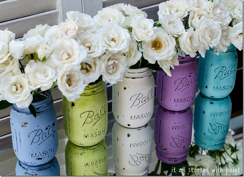Colorfully painted and distressed vintage style mason jars