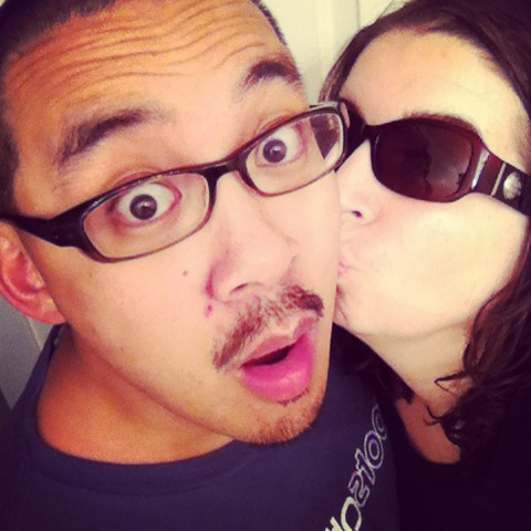 Movember Day 13- Sneaking a kiss. Lol. I'm wearing shades because I had just taken a shower and didn't want everyone to see me with no makeup. ;)