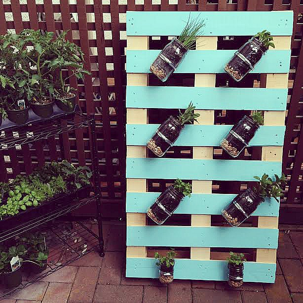 DIY Pallet Mason Jar Herb Garden Tutorial. This post has step by step instructions and tons of photos. A great family weekend project. 13