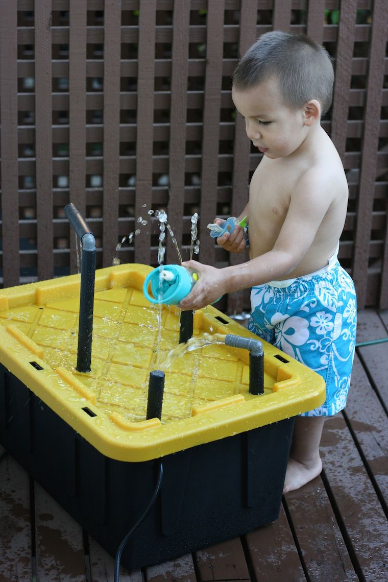 Upcycle a plastic storage container into an amazing DIY water spray table for kids with this fun weekend project! This would make a great birthday gift idea for a child and makes for hours of outdoor play!