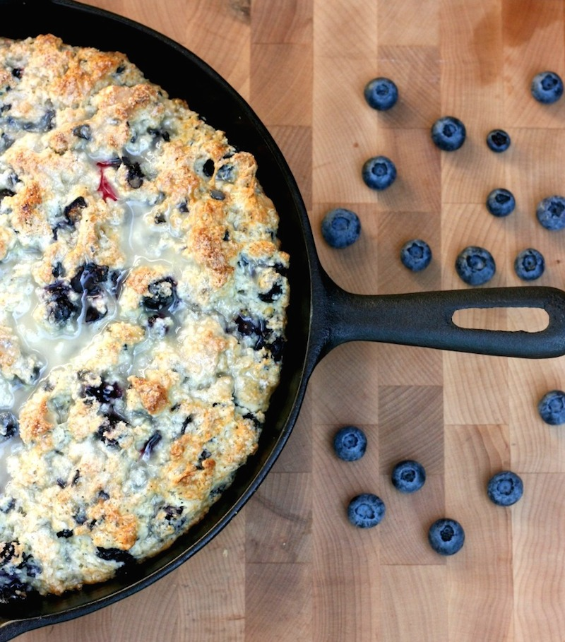 This Cast Iron Skillet Lemon Blueberry Scone Recipe is perfect for a no fuss weekend brunch or tea time. Sweet and tart, this recipe is easy to put together, looks pretty in the cast iron frying pan and is perfect for summertime entertaining.