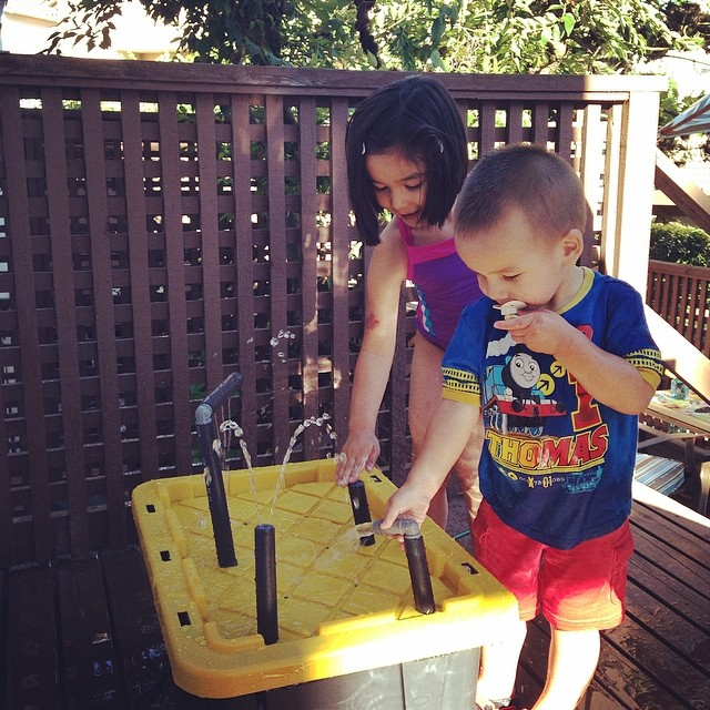 Exploring with the DIY Water Table that Daddy made for the first time