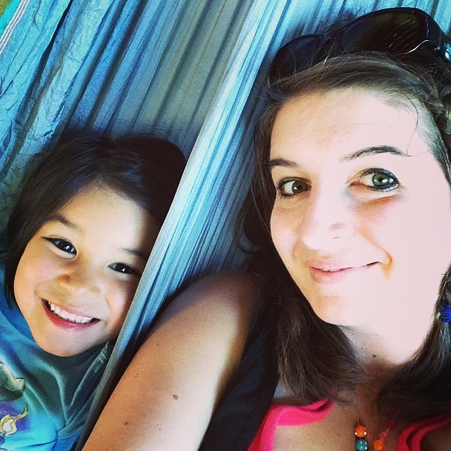 Hanging in the hammock with mom. (Notice my beautiful necklace Bean made me?)