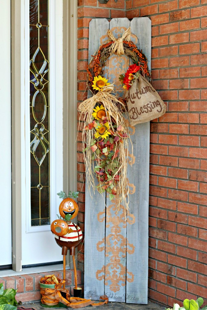 Autumn front porch decor with repurposed fence boards