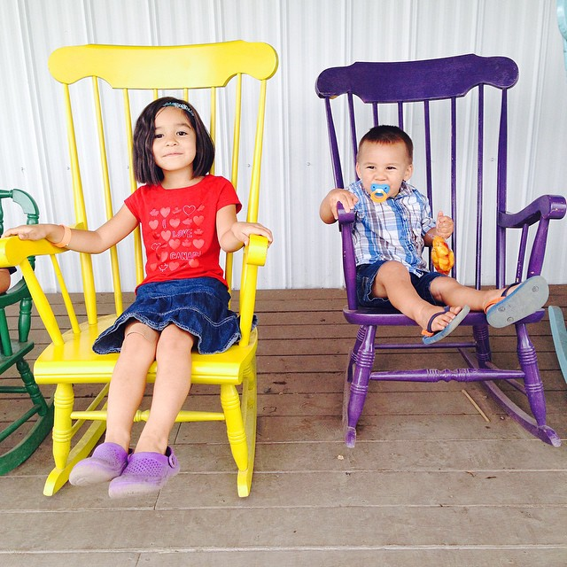 I love Meadow's Maze's porch full of brightly colored rocking chairs