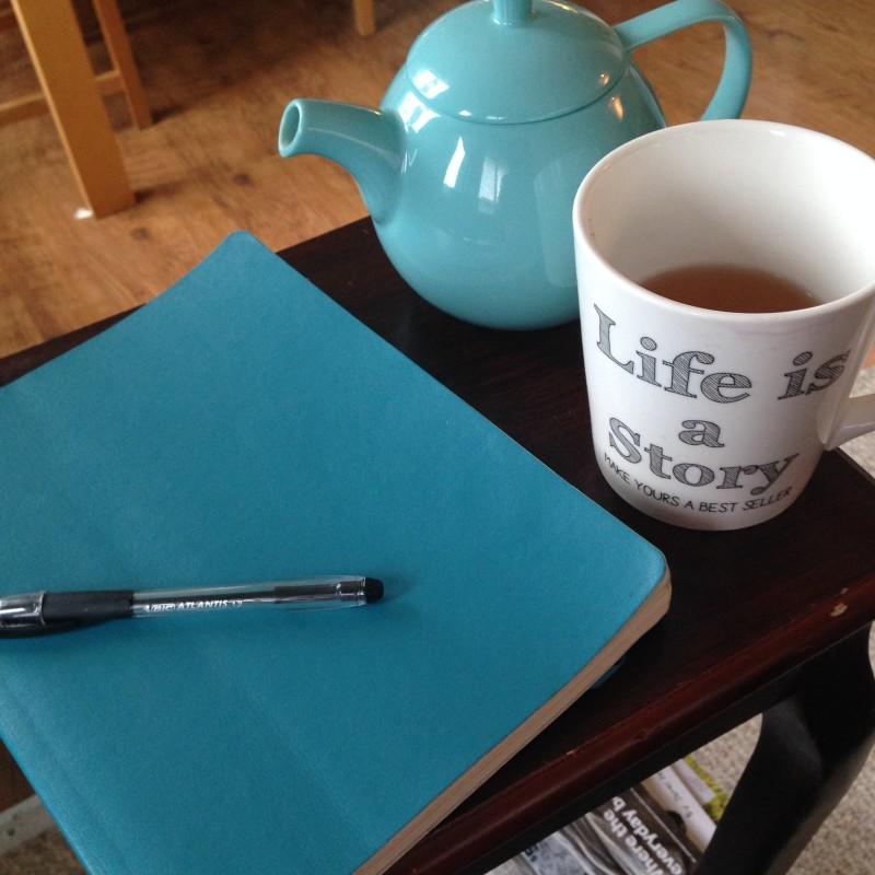 What I need to be creative. A pot of DAVIDsTEA, my favorite mug and my aqua blue Moleskine