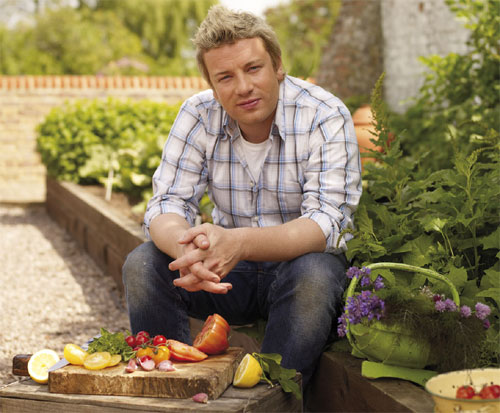 Yes, he is just as handsome and charming in real life as he appears on TV, maybe even more so.  I once again am crushing on Jamie Oliver