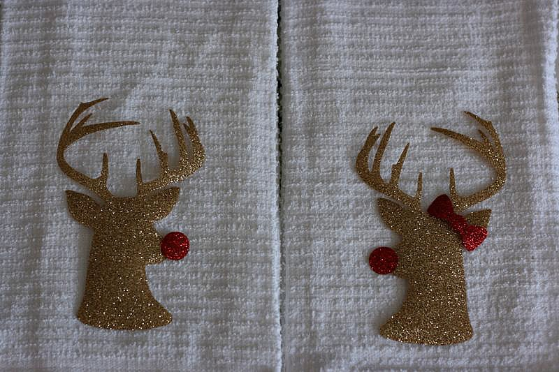 DIY Mr. & Mrs Rudolph Hand Towels from Sew Creative made on the Cricut Explore make the perfect Christmas Hostess Gift. Vinyl laid on towels ready to be ironed on