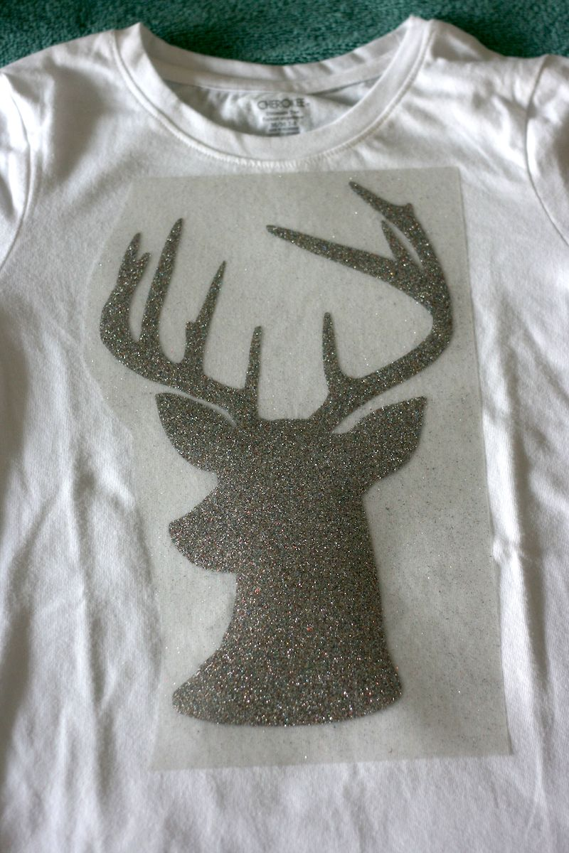 Sew Creative's Hipster Rudolph The Red Nosed Reindeer Hipster Shirt made on the Cricut Explore with Expressions Vinyl Waiting to be ironed