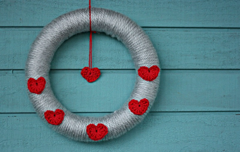 How to Make A Valentine's Day Wreath That Can Easily Be Repurposed for Any Season-Position your hearts and then tie yarn to top of the wreath to hang it.
