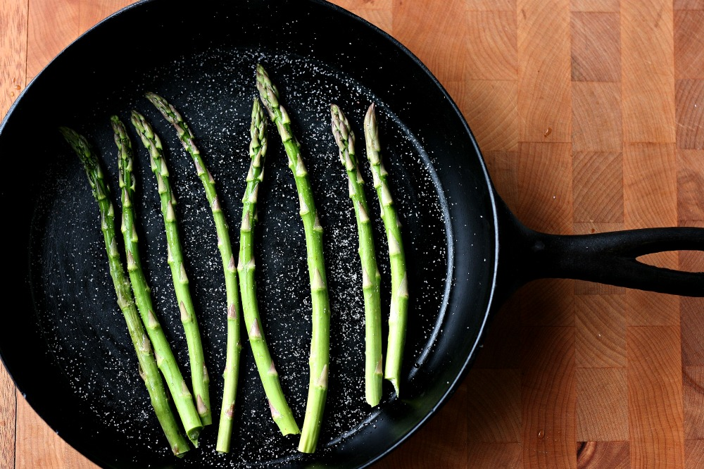 Back to basics- How to roast asparagus without oil. Put in a cast iron pan or non stick cookie sheet and sprinkle with sea salt