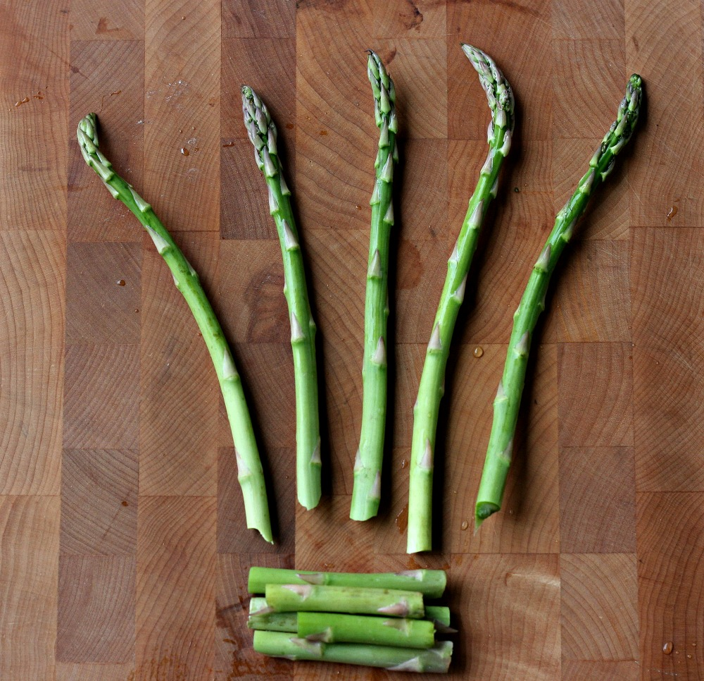 How to Roast Asparagus Without Oil- Step 2- Snap the bottom, woody bits off of your asparagus.