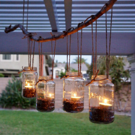 This easy DIY mason jar chandelier project is simple and uses supplies you probably have around the house. It would be beautiful for an outdoor wedding or a backyard party.