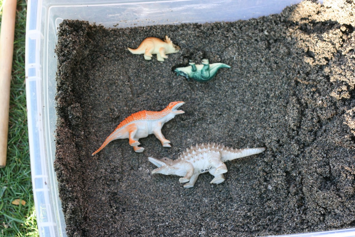 Make your own dinosaur excavation sensory bin. Perfect for palaeontologists to be