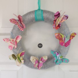 Looking for a fun project to make with leftover fabric scraps Check out this DIY Fabric Scrap Butterfly Wreath. So cute for hanging on your front door.