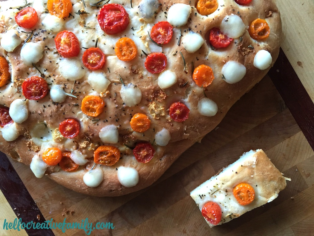 A good bread recipe should be a staple in every kitchen! Learn how to make our homemade focaccia bread recipe and modify it with flavors like cherry tomatoes and bocconcini