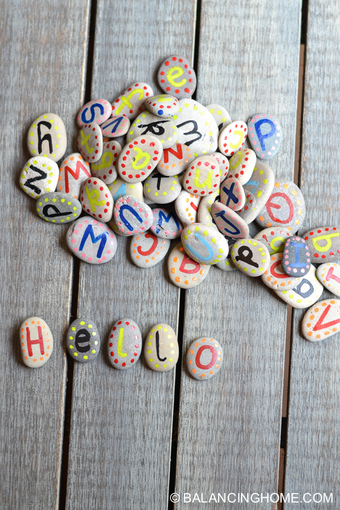 DIY Hand Painted Alphabet Rocks from Balancing Home