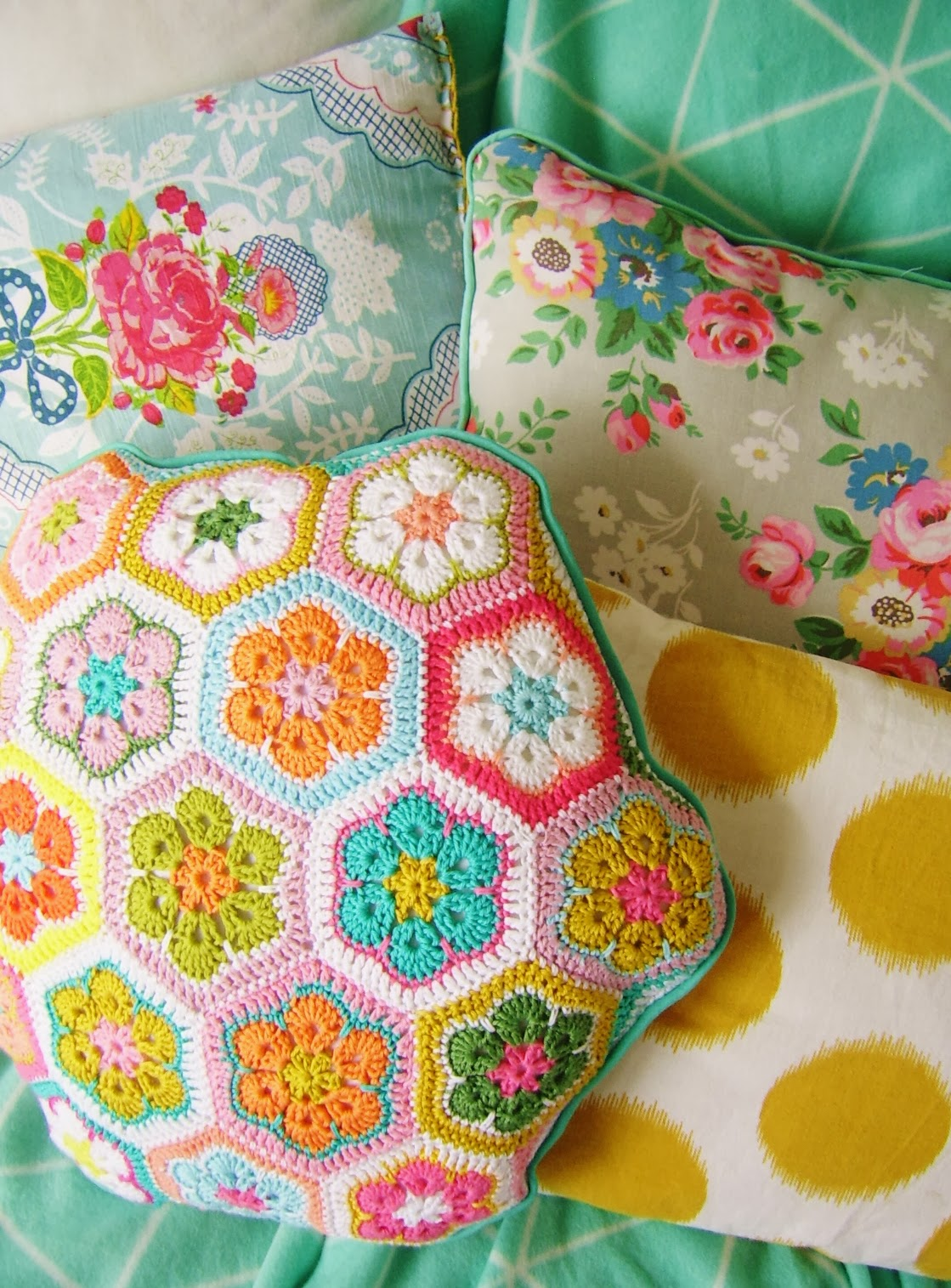 27 Crochet Projects That Are Going To Make You Want To Learn How To Crochet: African Hexigon Granny Square Pillow Crochet Pattern from Silly Old Suitcase