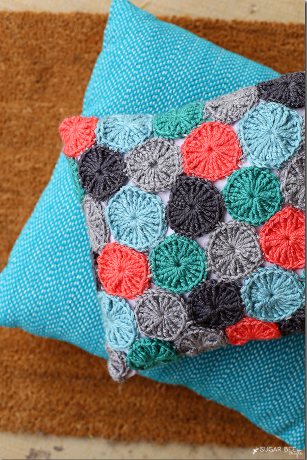 27 Crochet Projects That Are Going To Make You Want To Learn How To Crochet: Crocheted Yo-Yo Pillow Case Cover from Sugar Bee Crafts
