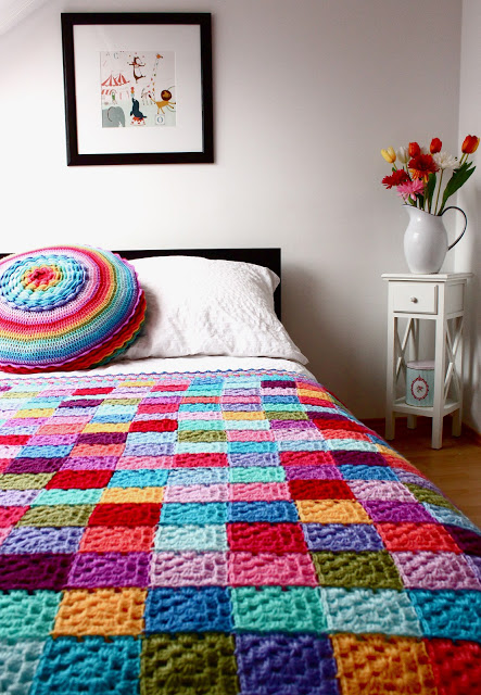 27 Crochet Projects That Are Going To Make You Want To Learn How To Crochet: Rainbow Granny Square Blanket from Boys and Bunting