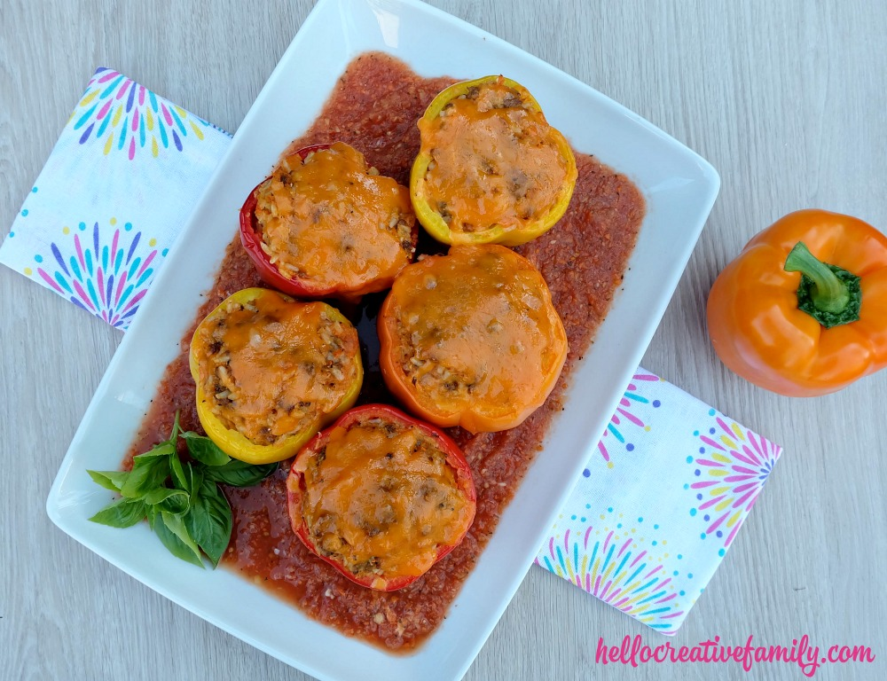 A quick and easy 30 minute weeknight meal idea! Italian Stuffed Bell Peppers Recipe with Rice, Ground Beef and Veggies! Parents will love it's packed full of hidden vegetables and kids will love the taste!