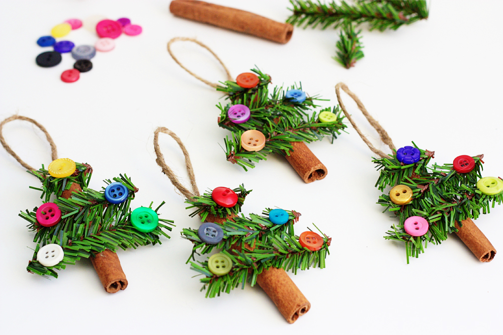 27+ DIY Christmas Ornaments Kids Can Craft- DIY Cinnamon Stick and Buttons Christmas Tree Ornaments from Consumer Crafts
