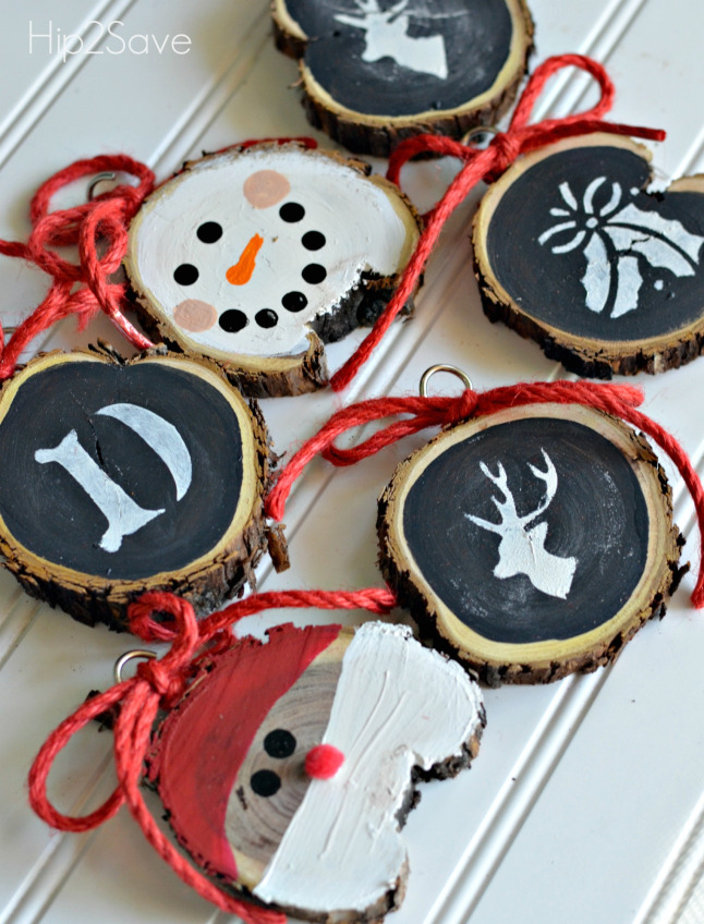 27+ DIY Christmas Ornaments Kids Can Craft- DIY Rustic Sliced Wood Santa, Snowman and Other Christmas Design Ornaments from Hip 2 Save