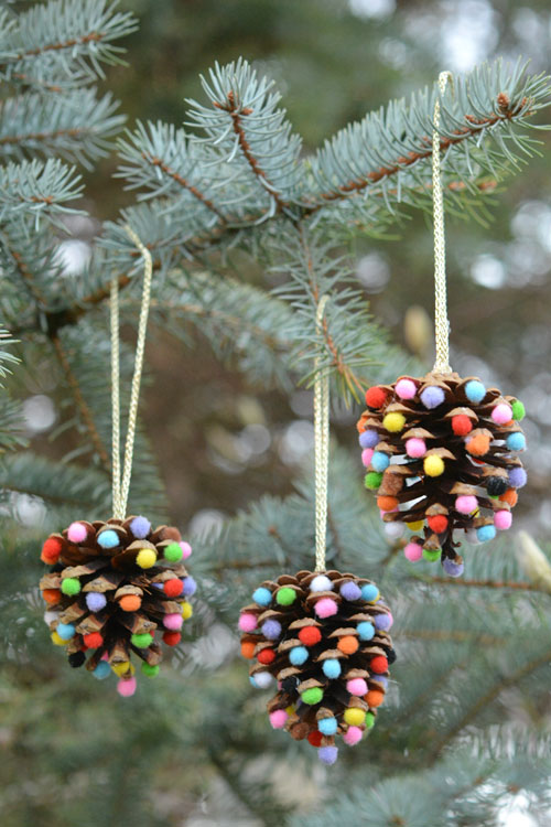27+ DIY Christmas Ornaments Kids Can Craft- Pom Pom Pinecone Ornaments from One Little Project