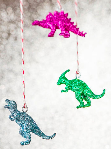 27+ DIY Christmas Ornaments Kids Can Craft- DIY Glitter Dinosaur Ornaments from Family Fun