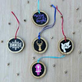 Upcycle your old Christmas tree, fallen branches, fence post and other wood that's going to go to waste with this fabulous craft project-- DIY Upcycled Wood Christmas Ornaments made using the Cricut Explore