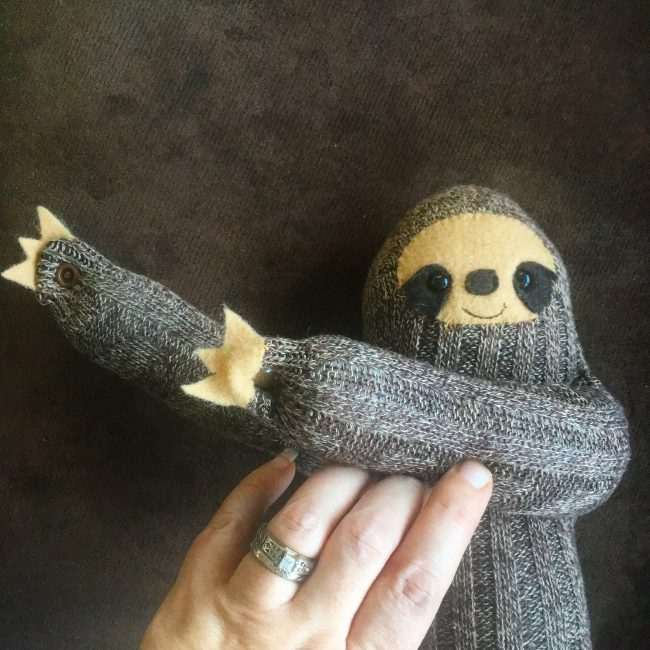 How sweet our these little DIY Sock Sloths? This would be the cutest handmade gift idea for a child or baby. Their hands have snaps so they can hang! Cut up a pair of socks and make one! DIY Sock Sloth Sewing Project on Hello Creative Family.