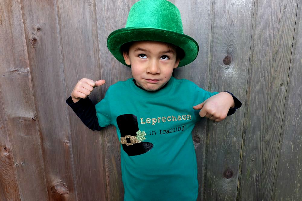 Your little leprechaun will be the cutest kid on the block with this DIY St. Patricks Day Shirt that says Leprechaun in Training. Has an easy step by step tutorial, instruction photos and free cut file for the Cricut. A great Cricut Project to make shirts for the whole family.