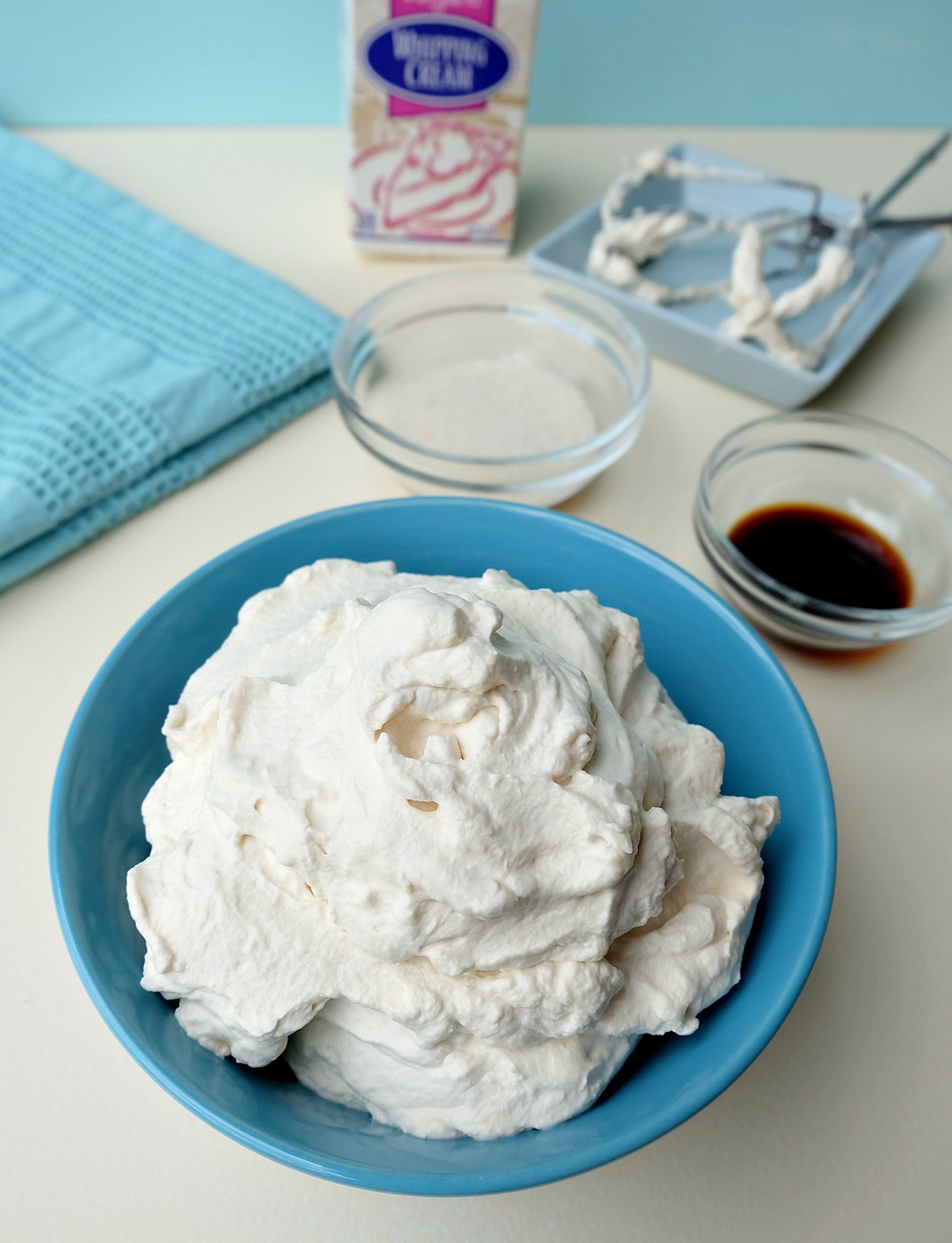 Toss the canned whipped cream! Making whipped cream from scratch is simple with Hello Creative Family's Easy Back To Basics How To Make Whipped Cream Recipe. All you need is whipping cream, sugar and vanilla! Control exactly how much sugar goes in and experiment with different flavor options like Pina Colada, Mocha Latte and Lemon Meringue whipped cream!