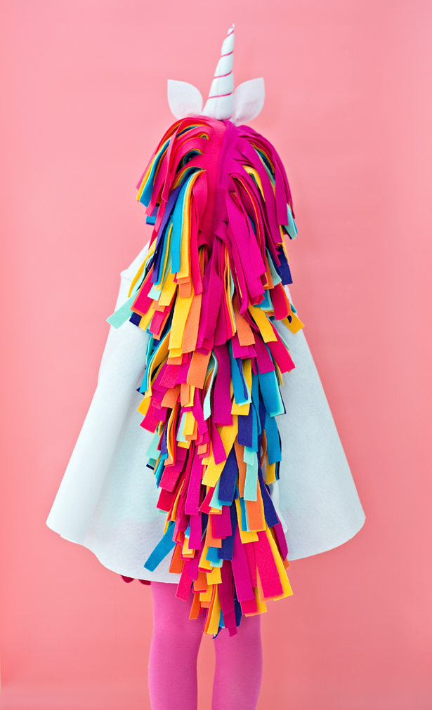 75+ Magically Inspiring Unicorn Crafts, DIYs, Foods and Gift Ideas: DIY No Sew Rainbow Unicorn Cape from Hello Wonderful