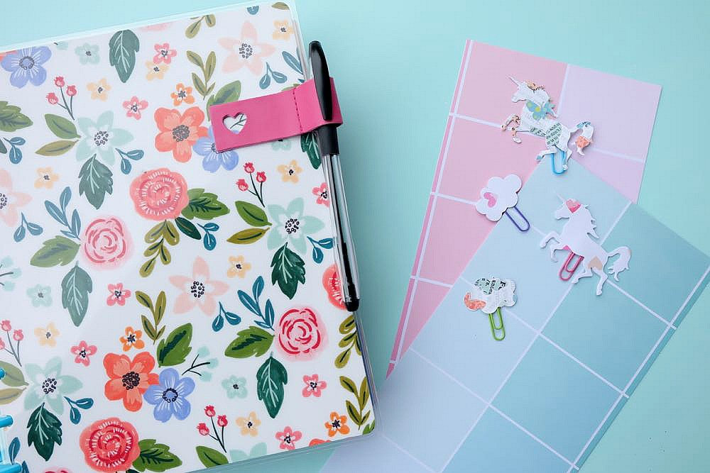Make pretty unicorn and cloud clips using scrapbook paper and colorful paperclips! This craft project is so easy and perfect for marking the page of your Happy Planner or bullet journal or to use as a bookmark for your favorite novel! Super Simple DIY Unicorn Planner Bookmarks!