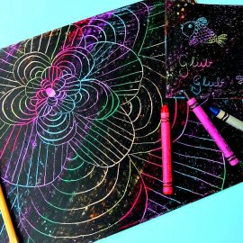 Do you remember doing crayon etching as a kid? It used to be one of our favorite kids crafts! Make this simple, colorful art with your kids with this easy tutorial. All you need is a box of crayons, paper and a chopstick!