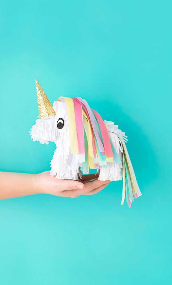 75+ Magically Inspiring Unicorn Crafts, DIYs, Foods and Gift Ideas: Unicorn Pinata from A Subtle Revelry