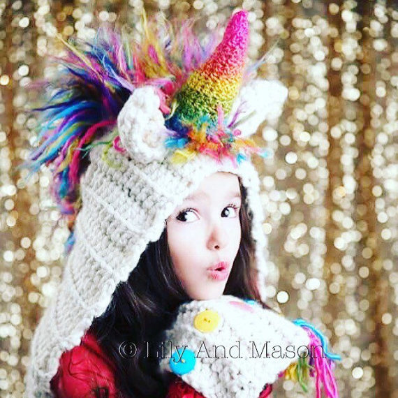 75+ Magically Inspiring Unicorn Crafts, DIYs, Foods and Gift Ideas: Unicorn Rainbow Hood Crochet Pattern from Lily and Mason Boutique