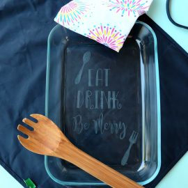 Making a gorgeous DIY Etched Glass Casserole Dish is so easy and makes a wonderful personalized handmade gift! Step by step photos are in this fun tutorial. A fun Cricut project that is perfect for wedding gifts, housewarming parties and entertaining guests! Includes a free cut file for the quote Eat, Drink, Be Merry!