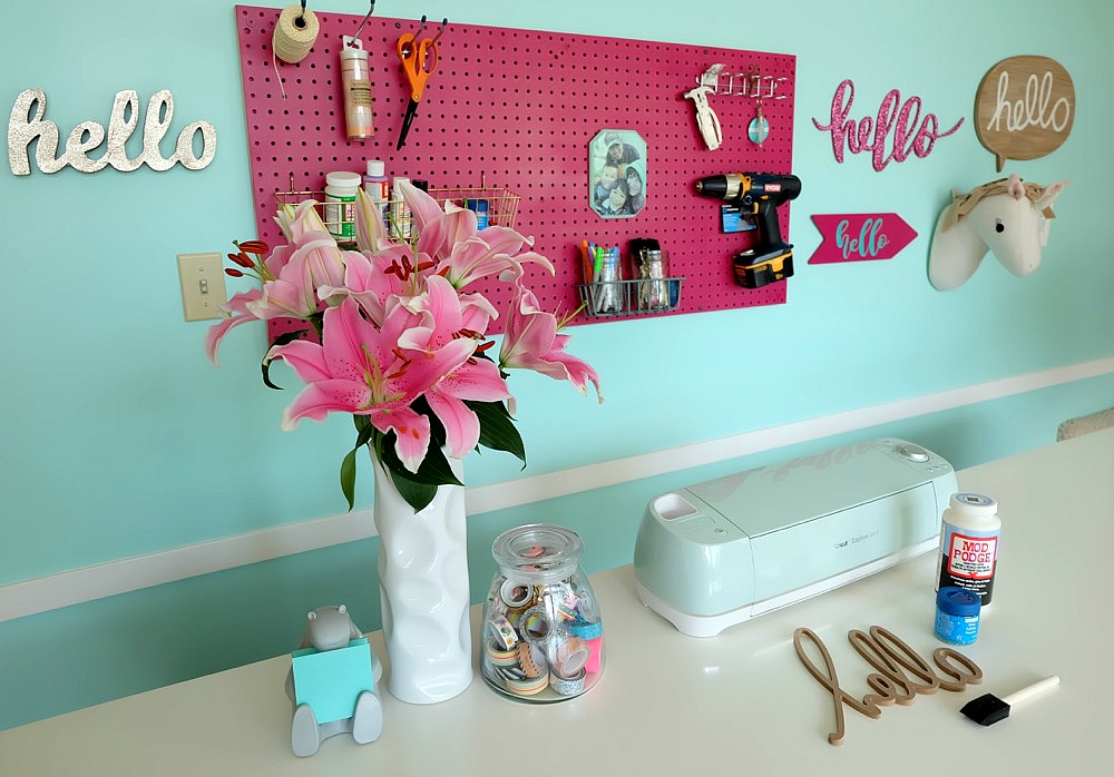 Take a sneak peek into behind the scenes of how Hello Creative Family transformed their tired old playroom into a gorgeous craft room video set! The craft table in this room is AMAZING. You will want to make your own craft room like this in your own house! #Sponsored by Wagner Paint Sprayers