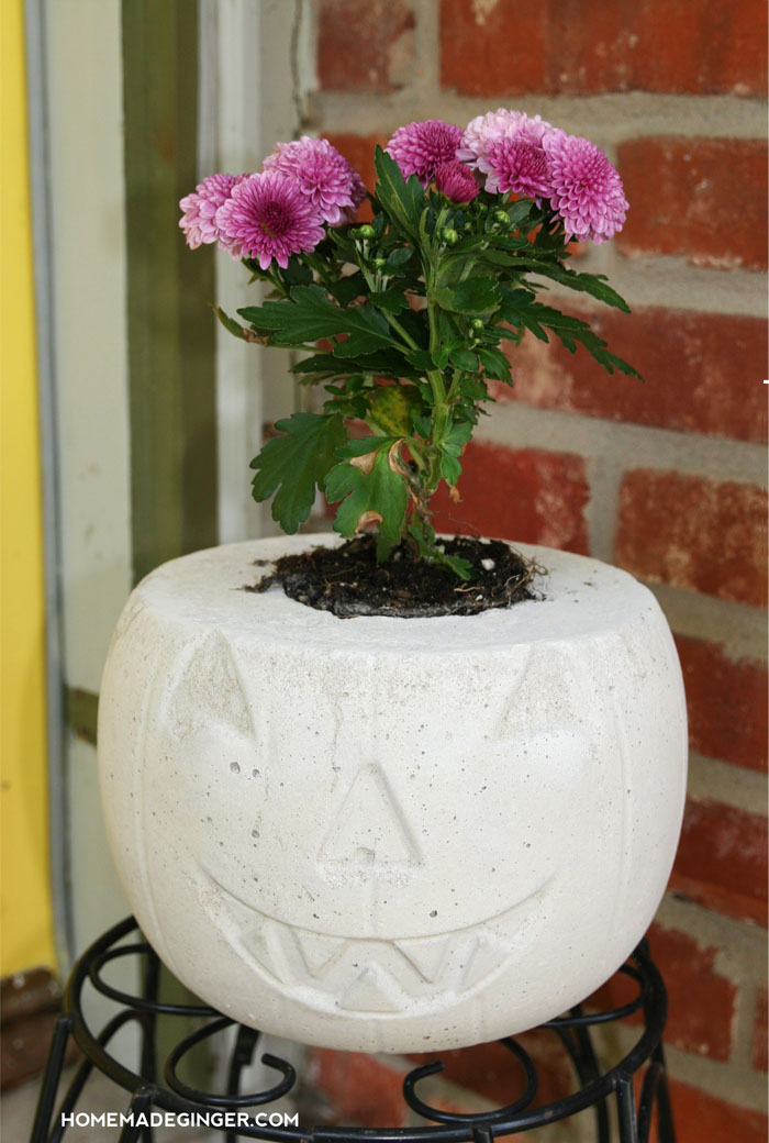 27+ Awesome Pumpkin Crafts, DIYs and Decorating Ideas- DIY Concrete Pumpkin Planter from Homemade Ginger