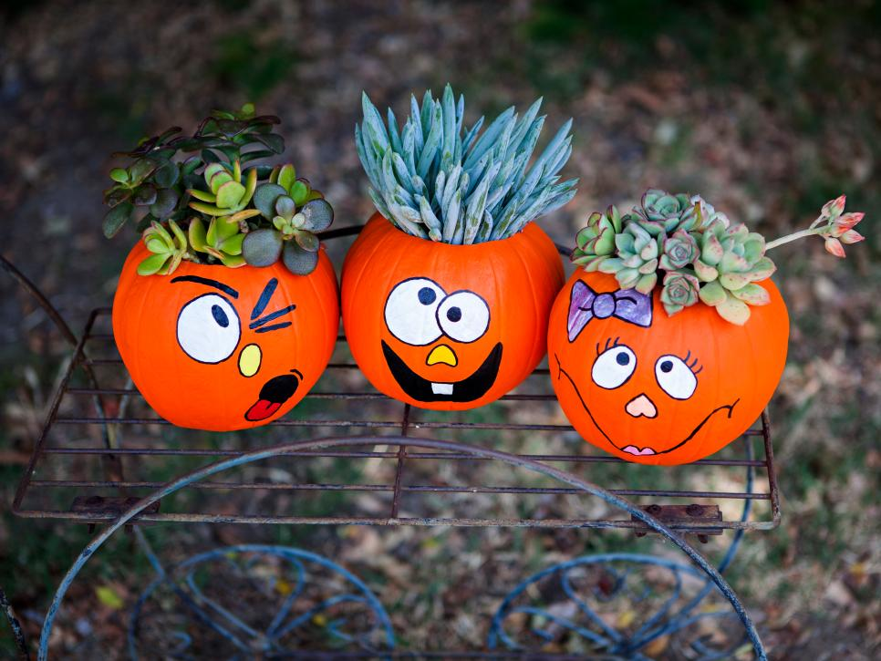 27+ Awesome Pumpkin Crafts, DIYs and Decorating Ideas- DIY Funny Face Pumpkin Planters from The DIY Network