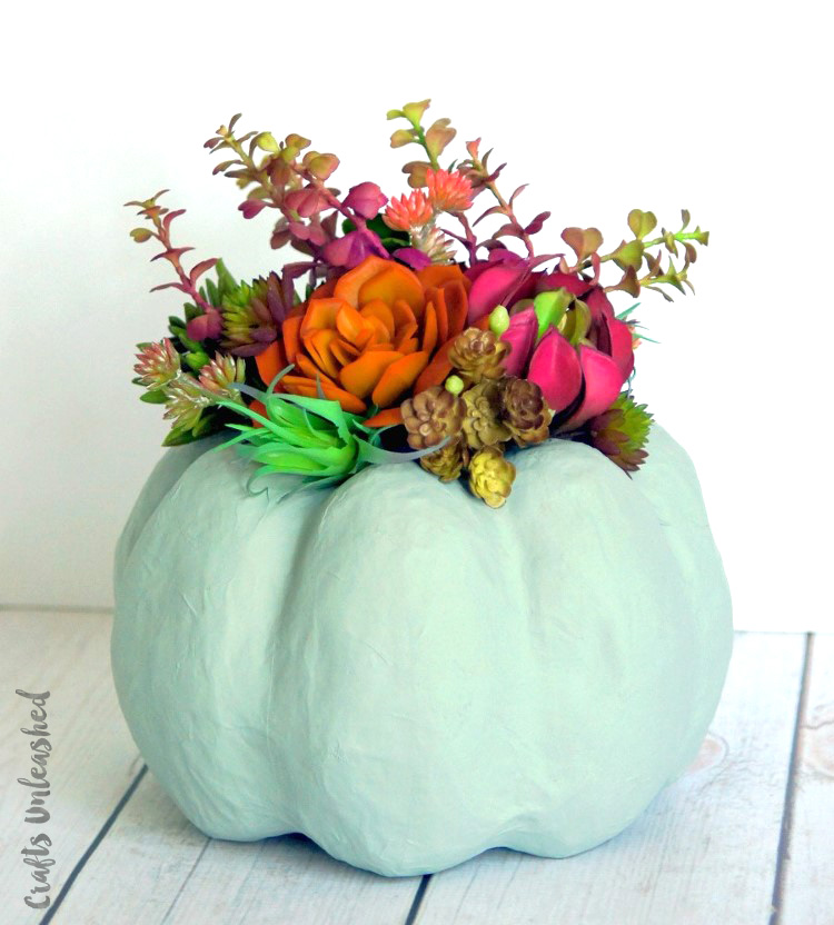 27+ Awesome Pumpkin Crafts, DIYs and Decorating Ideas- Faux Pumpkin Succulent Centrepiece from Consumer Crafts