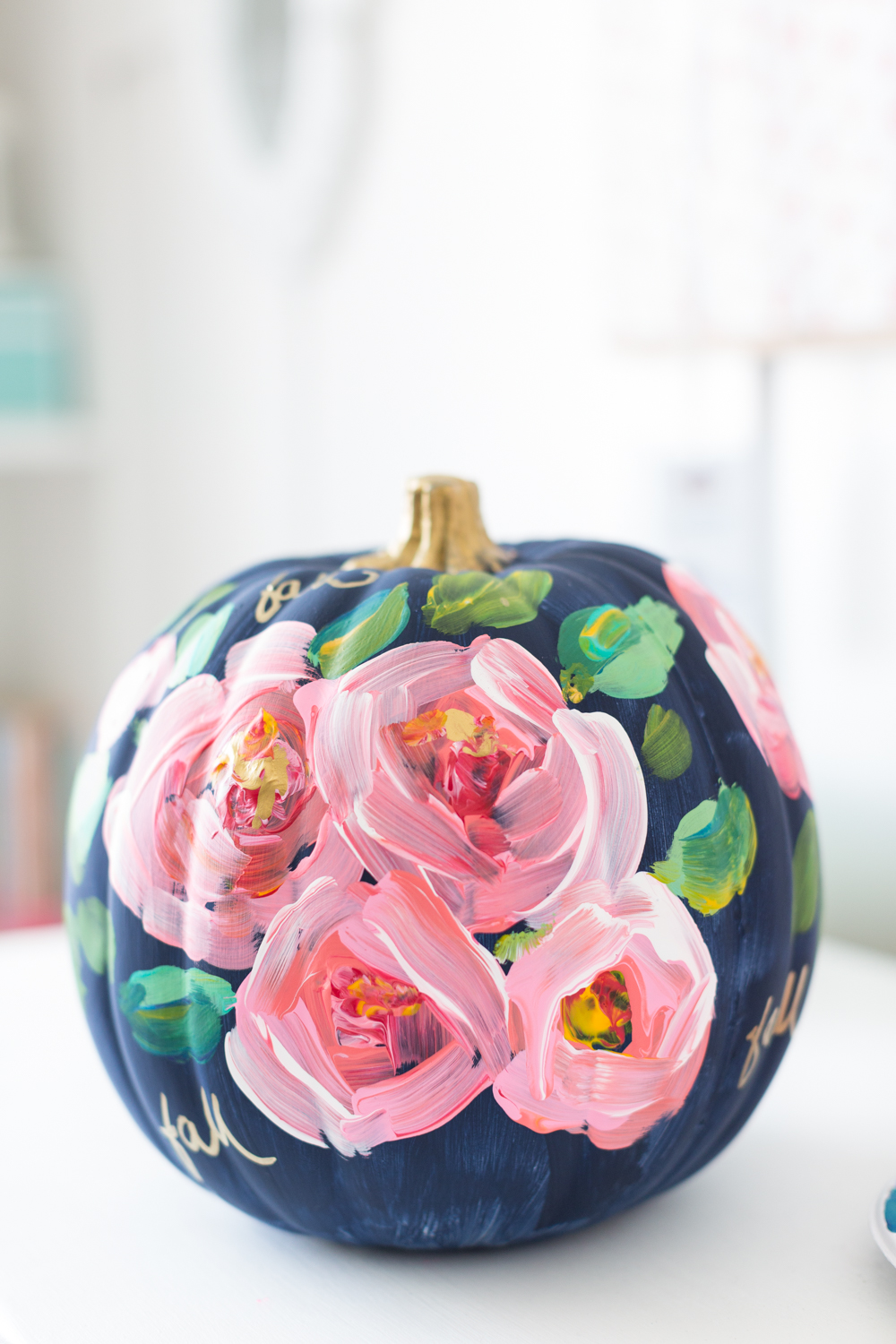 27+ Awesome Pumpkin Crafts, DIYs and Decorating Ideas- Hand Painted Floral Pumpkin from The Craftberry Bush