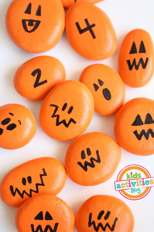 27+ Awesome Pumpkin Crafts, DIYs and Decorating Ideas- Painted Pumpkin Rocks Number Game from Kids Activities Blog