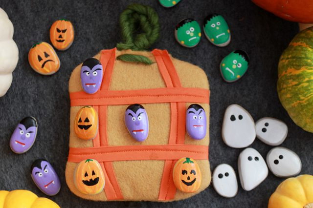 27+ Awesome Pumpkin Crafts, DIYs and Decorating Ideas- Painted Rock Pumpkin Tic Tac Toe set from eHow