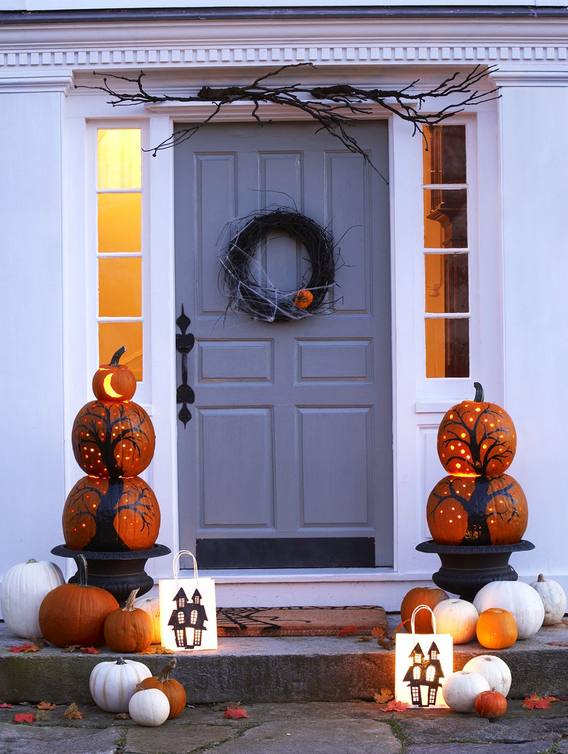 27+ Awesome Pumpkin Crafts, DIYs and Decorating Ideas- Pumpkin Tree Topiary from Good Housekeeping