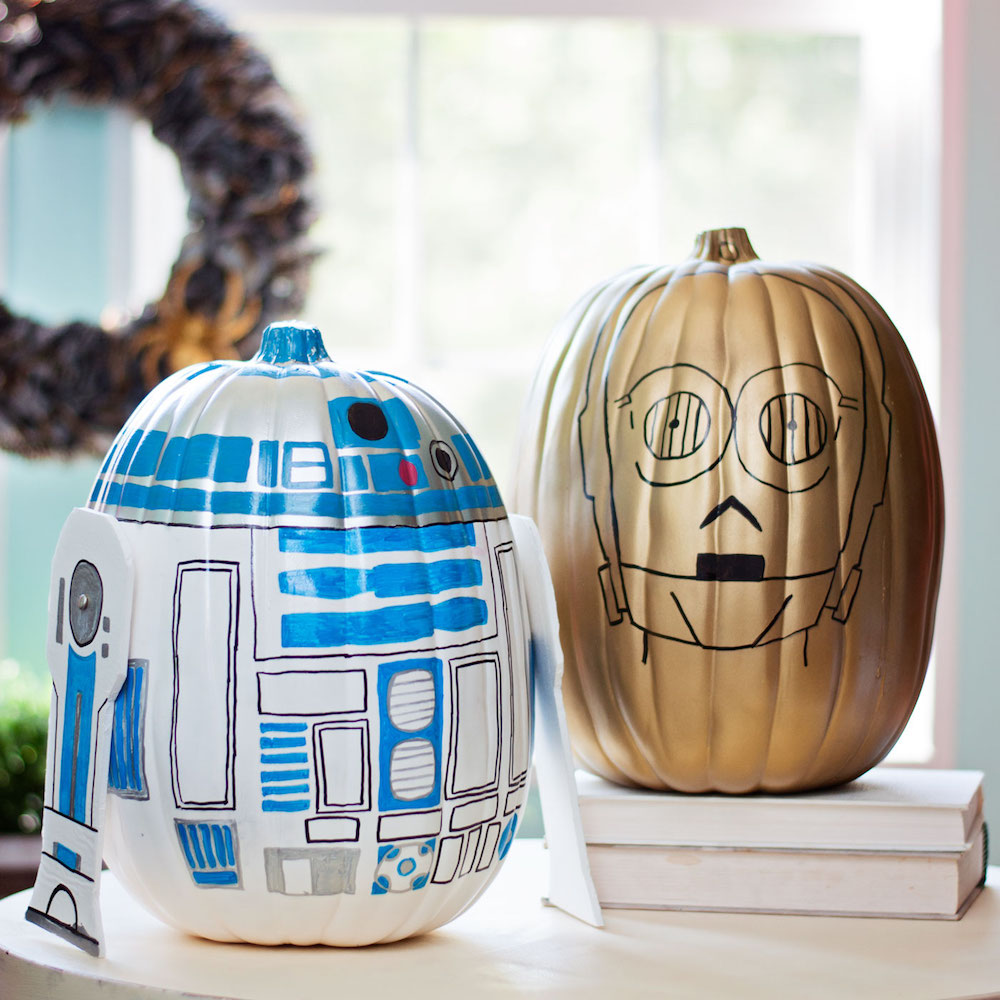 27+ Awesome Pumpkin Crafts, DIYs and Decorating Ideas- R2-D2 and C-3PO Star Wars Painted Pumpkins from Daily Candy