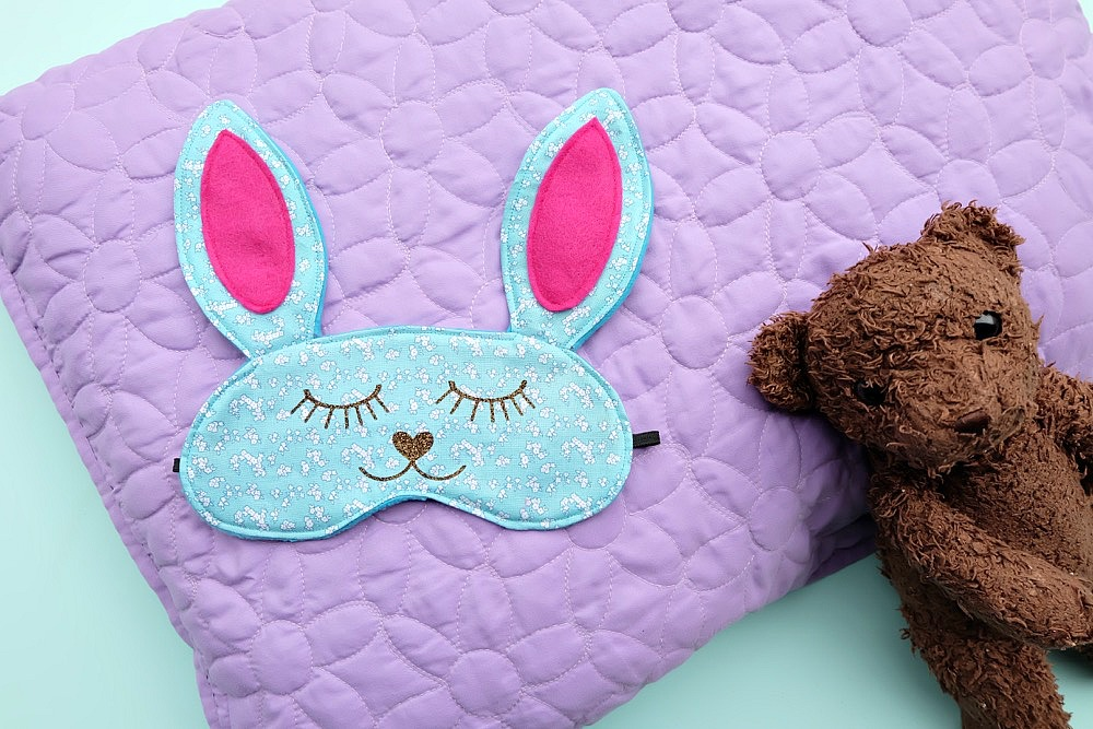 This 30 Minute Bunny Sleep Mask Sewing Tutorial is just about as cute as can be! Its easy to make and would make an adorable handmade gift idea for teens or tweens and would be perfect for birthday party or slumber party favors! Free cut file provided using the Cricut Maker or Cricut Explore. I have to make this Cricut project next! #sponsored #CricutMade #CricutMaker