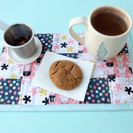 Bigger than a coaster and smaller than a placemat, a mug rug is a great handmade gift for coffee and tea drinkers! A great sewing project for beginners, this fabric scrap mug rug tutorial is easy and inexpensive to make! Cut the fabric with your Cricut Maker or by hand! #sewing #diy #craft #Cricutmaker